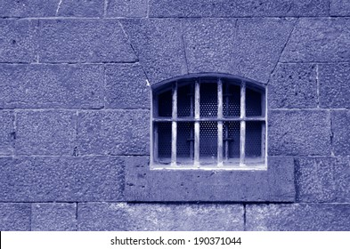Old prison cell window and wall. Concept photo of crime , prison, freedom, justice, punishment, captivity.