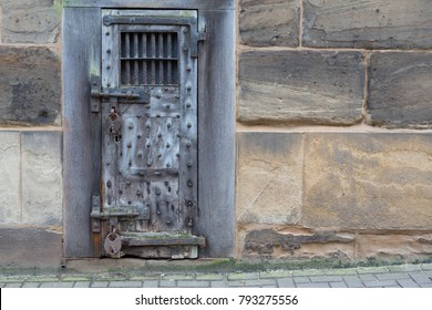 An old prison doorway in a stone wall wirth copy space