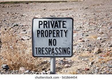 old private property no trespassing sign in the desert