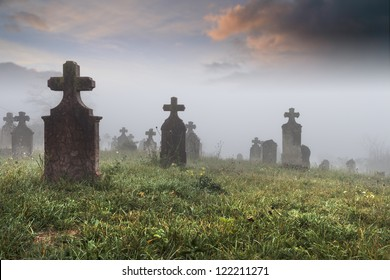 Old provincial cemetery on a cold foggy morning