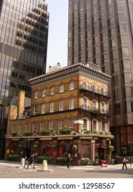 Old pub between modern office buildings
