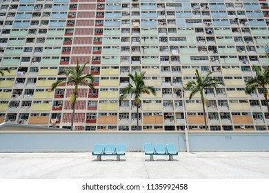 Old public housing with chair in Hong Kong