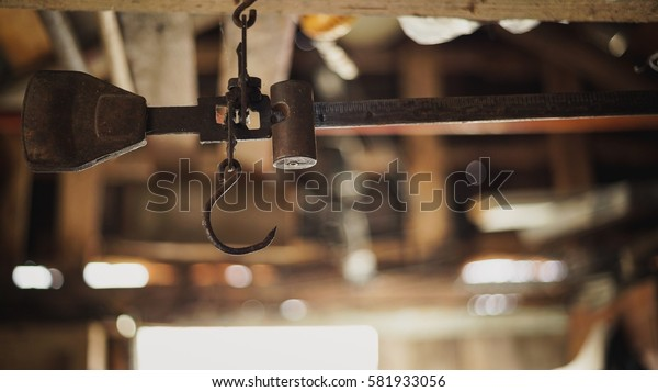 Old pulley with rope (pulley) in selective focus with blurred background