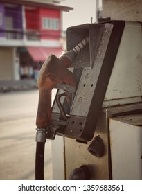 Old pump filling gun fuel nozzle to refuel gas station in thailand.