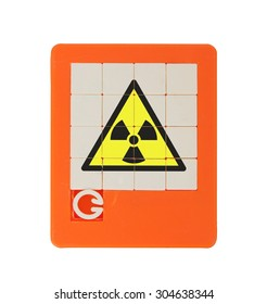 Old puzzle slide game, isolated on white - radiation (danger) symbol