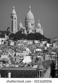 Old quarter of Montmartre in Paris and the Sacre-Coeur Basilica