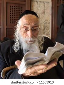 Old rabbi prays in the western wall in Jerusalem.
