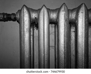 Old radiator covered with dust and spiderweb. Monochrome color.