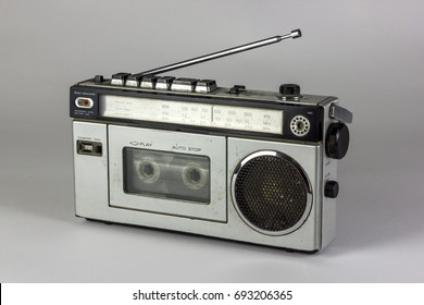 old radio and cassette recorder isolated on white background