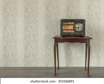 Old radio is on the table in an empty room