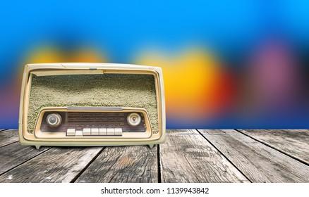 Old radio on wooden floor tilt