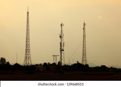 Old radio towers against twilight sky