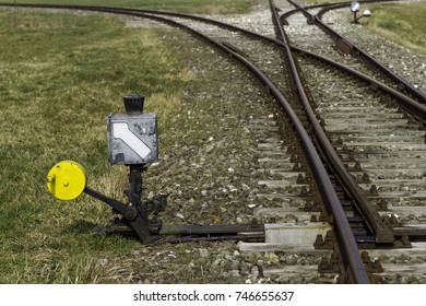 Old rail track with railroad switch and adjusting lever.
