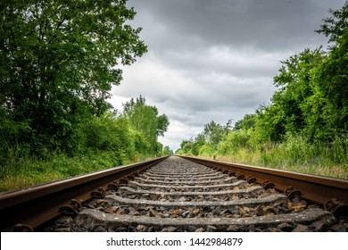 old rail tracks lead to the horizon