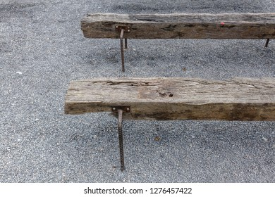 Old railroad sleeper chair recycle from wooden railway and use a steel bar to make a chair leg.