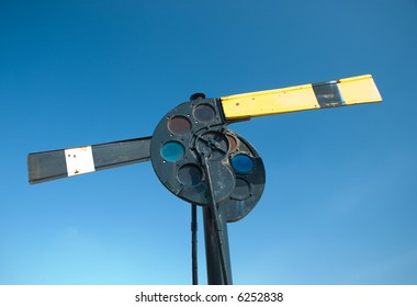An old railroad stop and go signal, with two arms