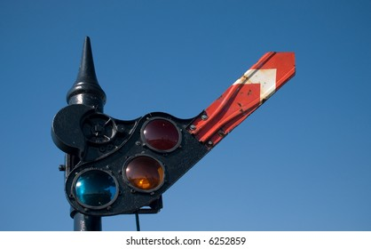An old railroad stop and go signal, with one arm