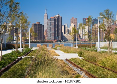 Old railroad tracks and view of New York City Skyline at Gantry Plaza State Park