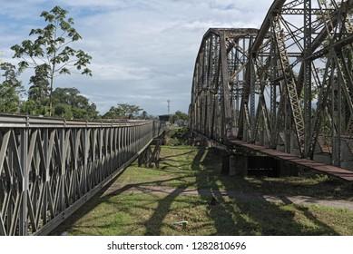 Old railway and border bridge across the Sixaola River between Costa Rica and Panama