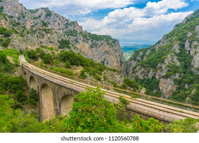 The old railway bridge of the Asopos river near village Iraklia at national park of Oiti in Central Greece