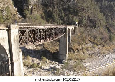 Old railway bridge over the river Fella (Territory of Dogna), which rises near Malborghetto Valbruna to then emerge into the Tagliamento. Alpe Adria road, Friuli Venezia Giulia, Italy.