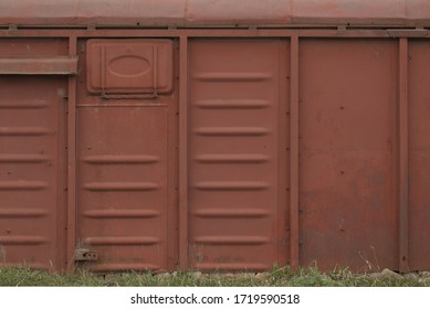 Old railway car. A close up view of the side of a railroad car. Rusty metal texture.