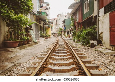 Old railway in slum area, Hanoi, Vietnam. Travel blog background