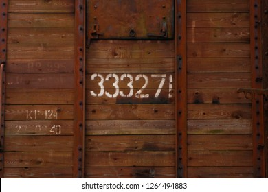 Old railway station wagon with numbers.