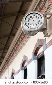 old railway station-clock on a platform