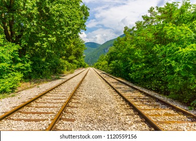 An old railway track near old railway station at national park of Oiti in Central Greece
