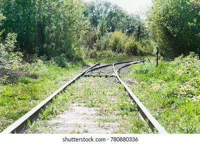 Old railway tracks. Derelict railway.