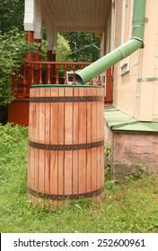 Old rainwater barrel near house, Russia
