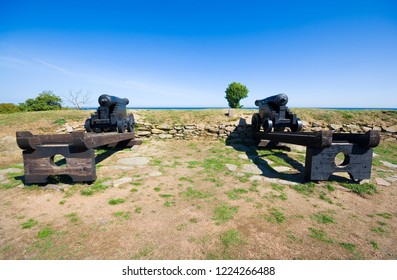 Old rampart with its cannons on the coast of Baltic sea in Svaneke, Bornholm, Denmark