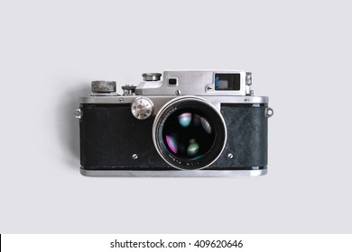 Old rangefinder camera on white background. Vintage style