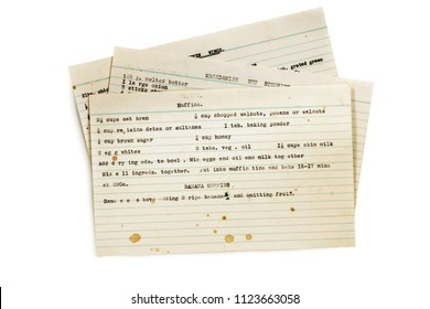 Old recipes typed on index cards, isolated on white.