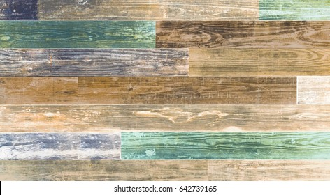 Old reclaimed wood background wall. Natural old shabby wood boards with turquoise faded colors. Horizontal wide screen image with copy space.