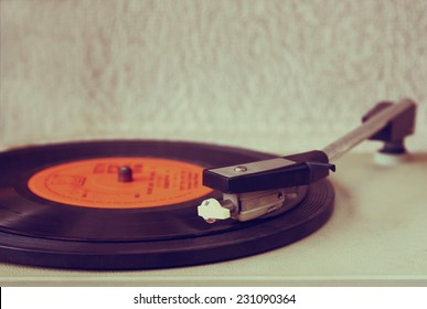 old record player, image is retro filtered. selective focus