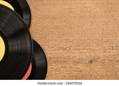 Old records on wooden table