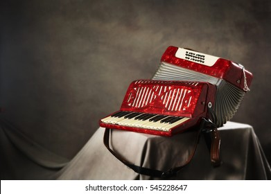 Old red accordion isolated