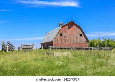 An old red barn in a farm yard in summer