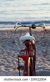 Old red bike on the beach