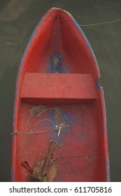 Old red boat on the dark water