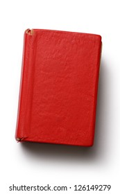 Old red book on white background