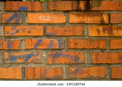 Old red brick. Brickwork. Old brickwork. The wall is built of red brick. Architectural texture.
