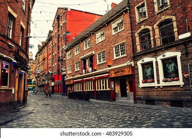 Old red brick buildings in the city center of Liverpool, UK. Restaurants, bars and shops. Vintage street