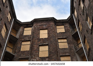 Old red brick house in a former Jewish ghetto from World War II at Kamienico, Walicow street, Warsaw city, Poland