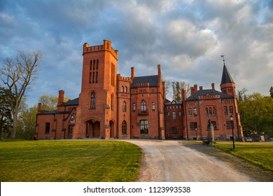Old red brick manor house in the style of English castles. Sangaste, Estonia.