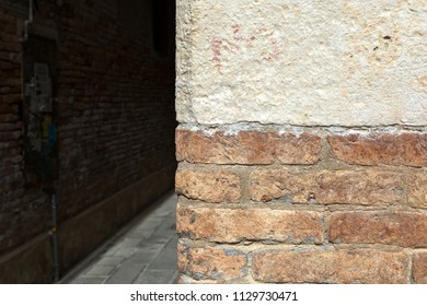 Old red brick wall and bystreet background.