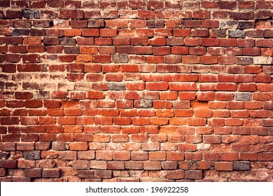 Old red brick wall, grunge background.
