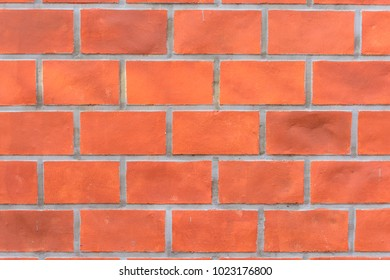 Old red brick wall texture background.